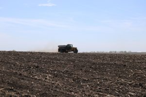 Applicator spreading SO4 in farm field